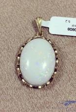 Vintage 14 carat gold pendant with large opal