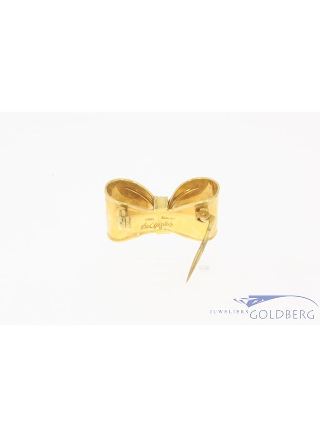 Vintage 18 carat gold bow brooch with ca. 0.035ct brilliant cut diamond