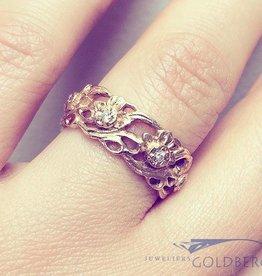 Vintage 18k gouden versierde ring met ca. 0.14ct briljant