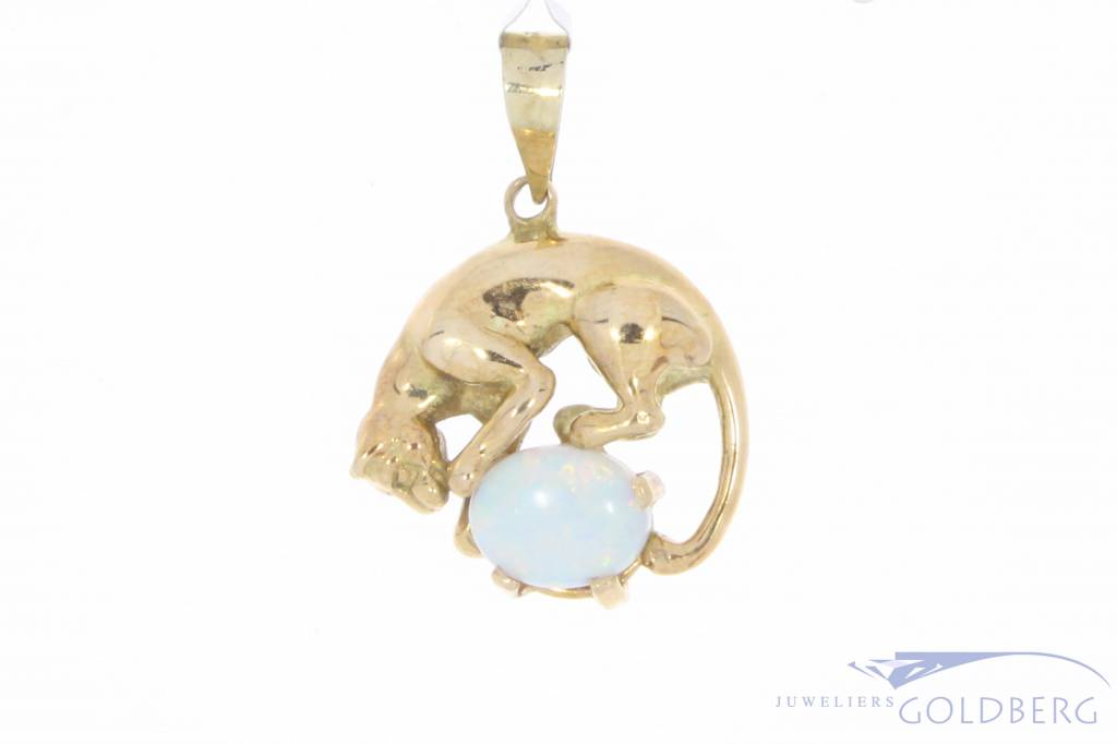Vintage 14 carat gold panther pendant with opal