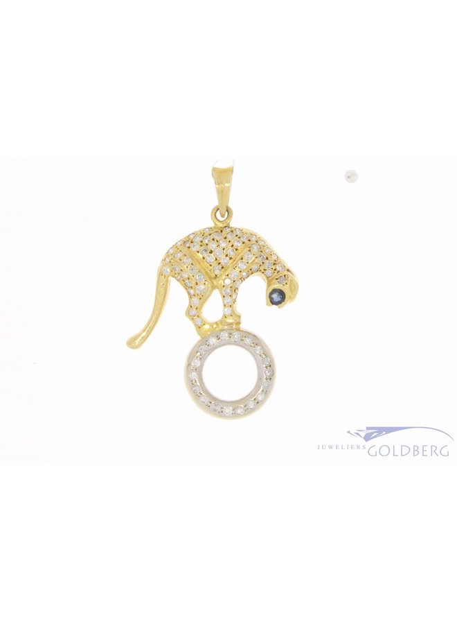 18 carat bicolor gold panther pendant with ca. 0.92ct brilliant cut diamond and sapphire