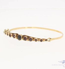 Vintage 14 carat gold bangle with garnet