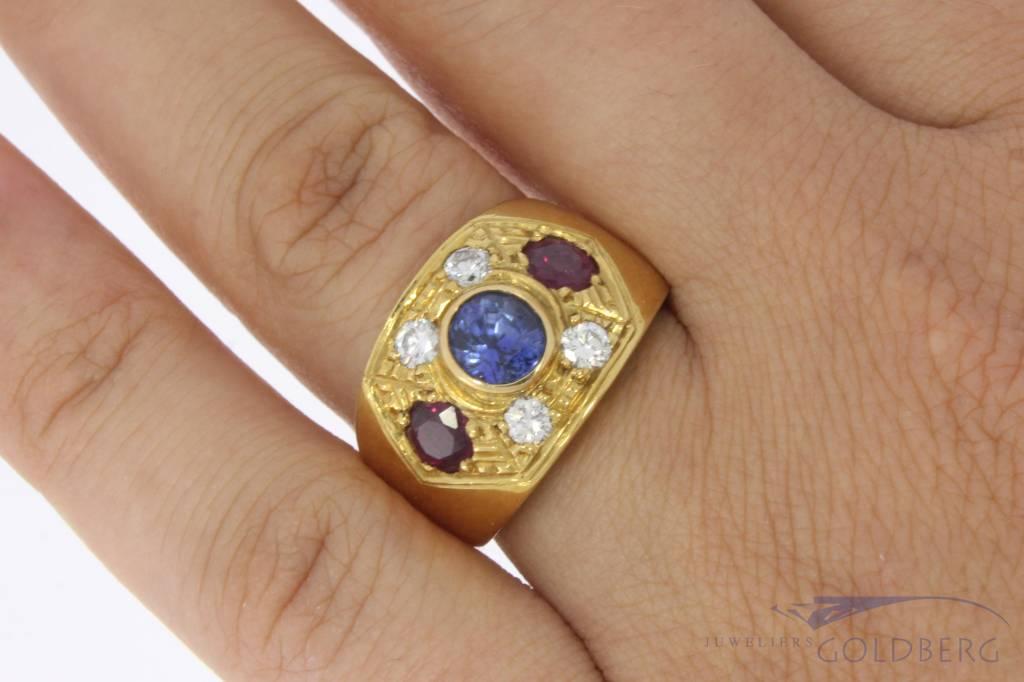 Zware 18k gouden ring met ca. 0.44ct briljant, robijn en saffier