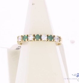 Vintage 14 carat gold alliance ring with emerald and zirconia