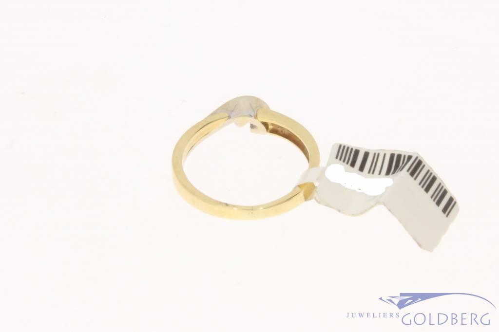 Vintage 14 carat bicolor gold solitair ring with ca. 0.05ct brilliant cut diamond