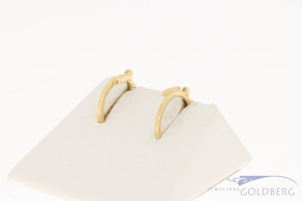 Vintage 14 carat gold Paul van den Hout half creole earrings