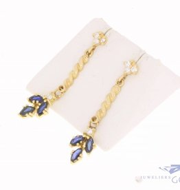 Vintage 18 carat gold hanging earstuds with sapphire and ca. 0.20ct brilliant cut diamond