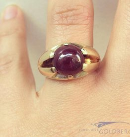 Heavy vintage 14 carat gold ring with large ruby