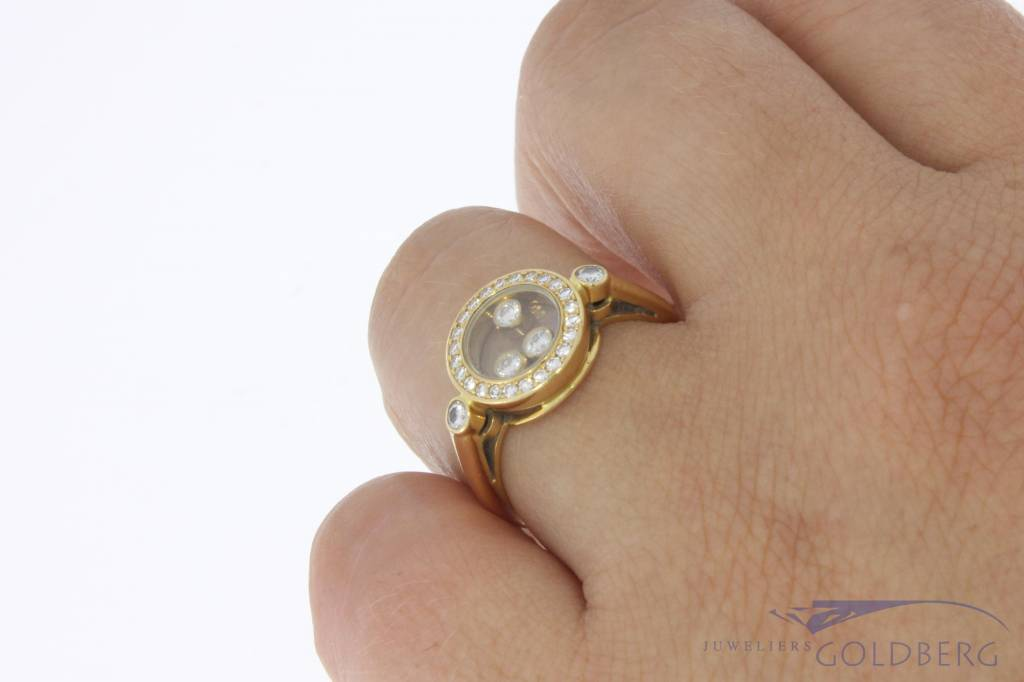 Vintage 18 carat gold Chopard Happy Diamonds ring with approx. 0.28ct brilliant cut diamond