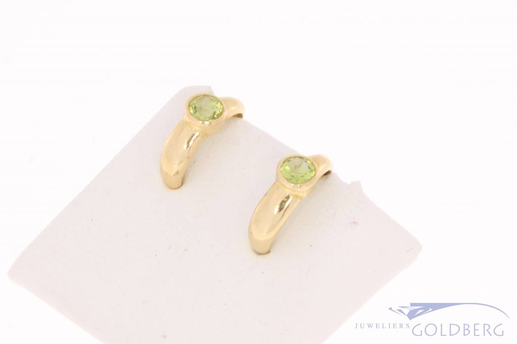 Vintage 18 carat gold half creole earrings with peridot