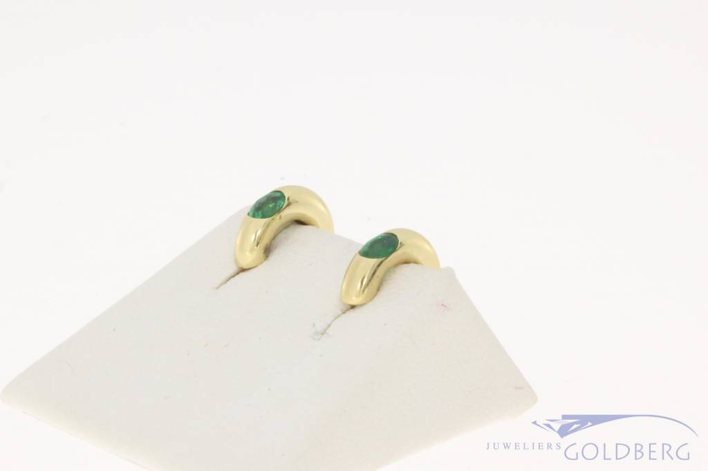 Vintage 14 carat half creole earrings with emerald
