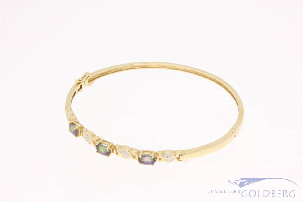 Vintage 14 carat gold bangle with tourmaline and approx. 0.04ct diamond
