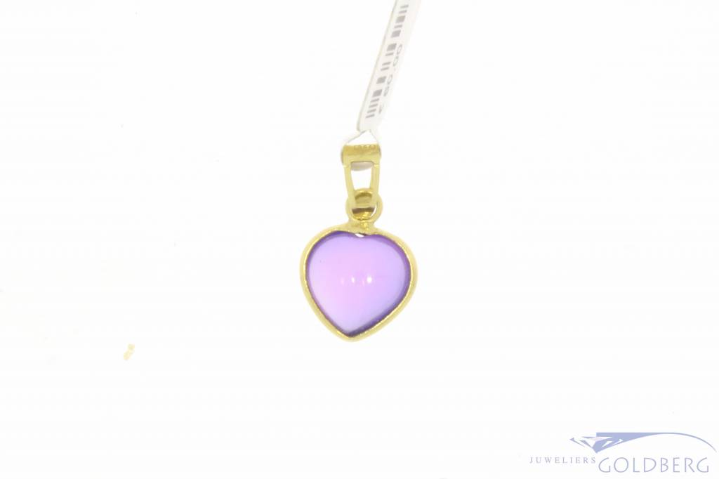 Vintage 18 carat gold heart-shaped pendant with amethyst