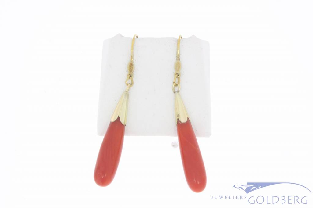 Vintage 14 carat gold earrings with large red coral