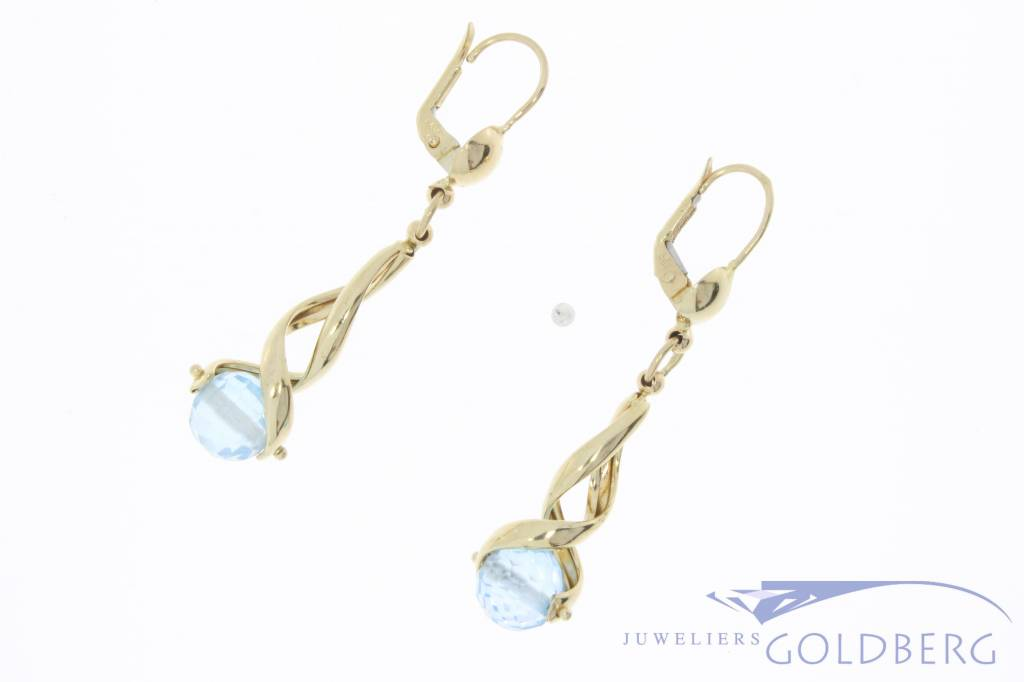Vintage 14 carat gold earrings with facet cut bead