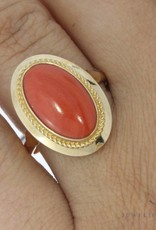 Vintage 14 carat gold ring with oval red coral