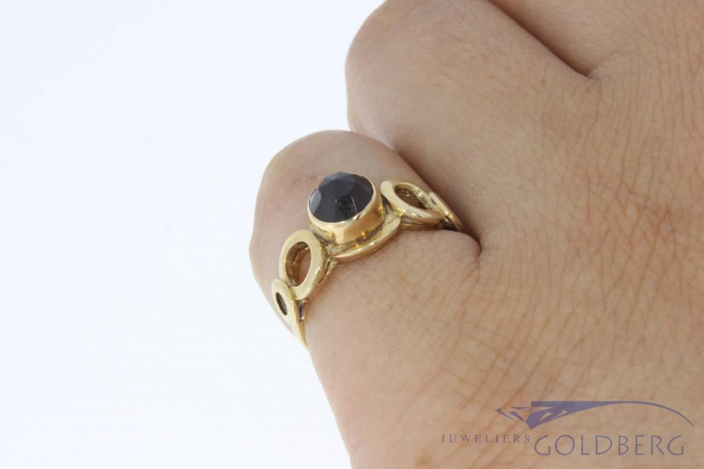 Vintage 14 carat gold ring with faceted garnet