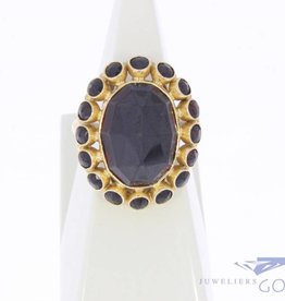 Large vintage 14 carat gold ring with garnets