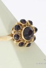 Vintage 14 carat gold ring with facet cut garnet