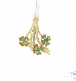 Vintage 14 carat gold floral pendant with emerald