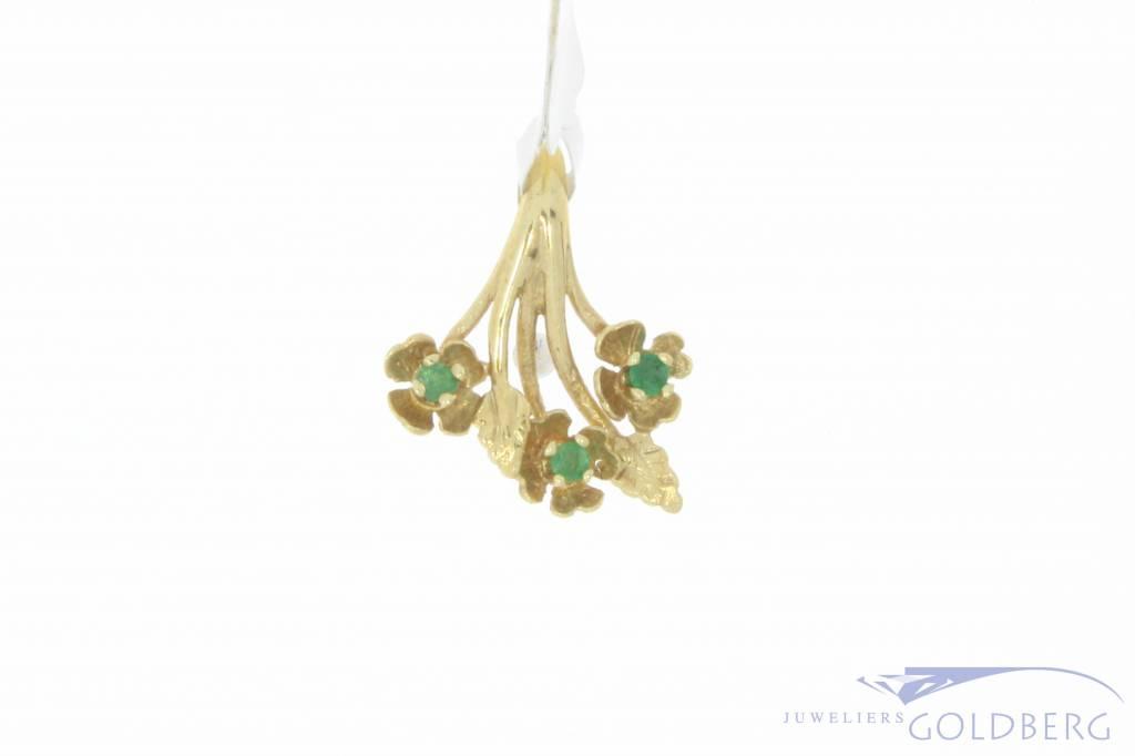 Vintage 14 carat gold floral pendant with emerald