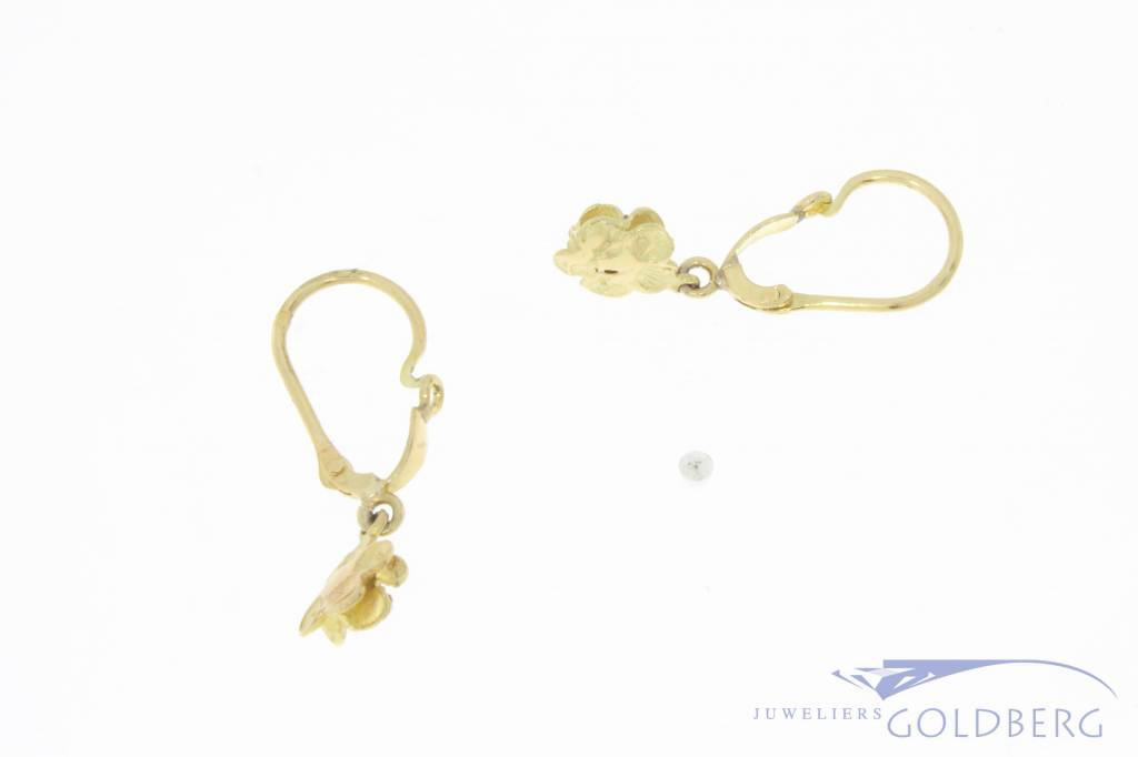 Vintage 18 carat gold flower shaped earrings with ruby
