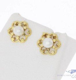Vintage 14k gouden bloemvormige oorstekers met parel