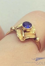 Vintage 14 carat gold design ring with blue sapphire