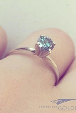 14 carat white gold solitaire ring with approx. 0.65ct brilliant cut blue diamond
