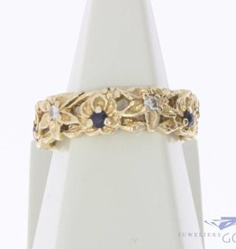 Robust vintage 14 carat gold ring with blue sapphire and approx. 0.15ct brilliant cut diamond