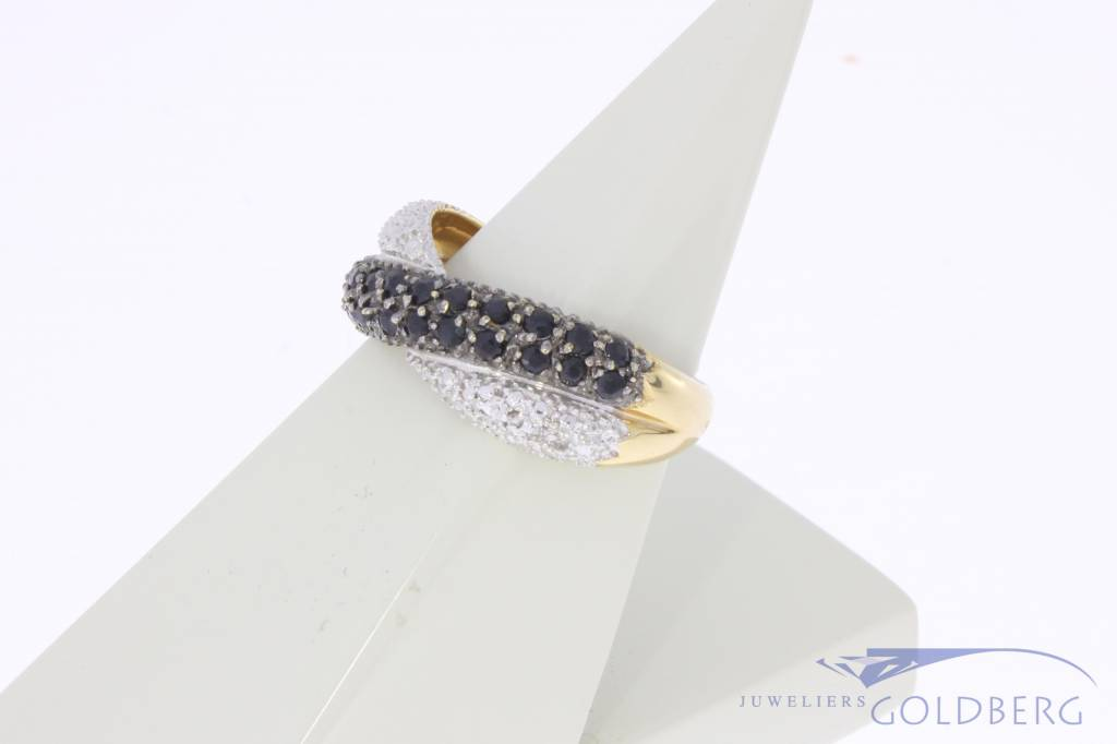 Vintage 18 carat bicolor gold ring with blue sapphire and approx. 0.45ct diamond