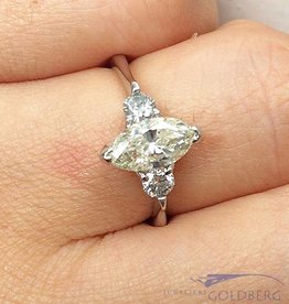 18 carat white gold ring with approx. 1.25ct marquis & brilliant cut diamond