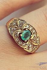 Vintage 18 carat gold ring with emerald and approx. 0.26ct brilliant cut diamond