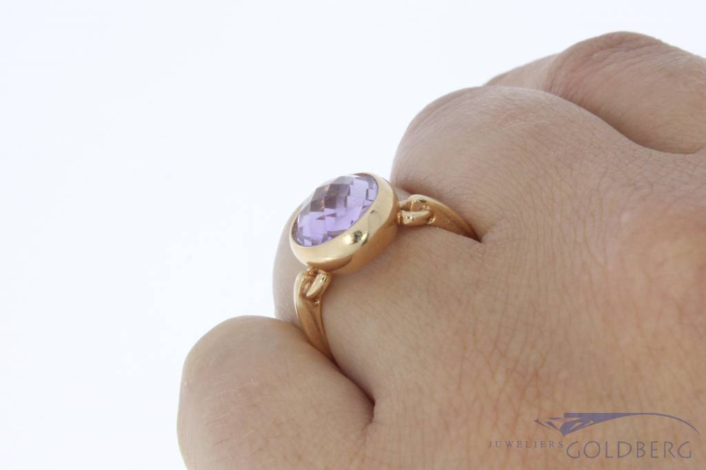 18 carat rose gold design ring with faceted amethyst