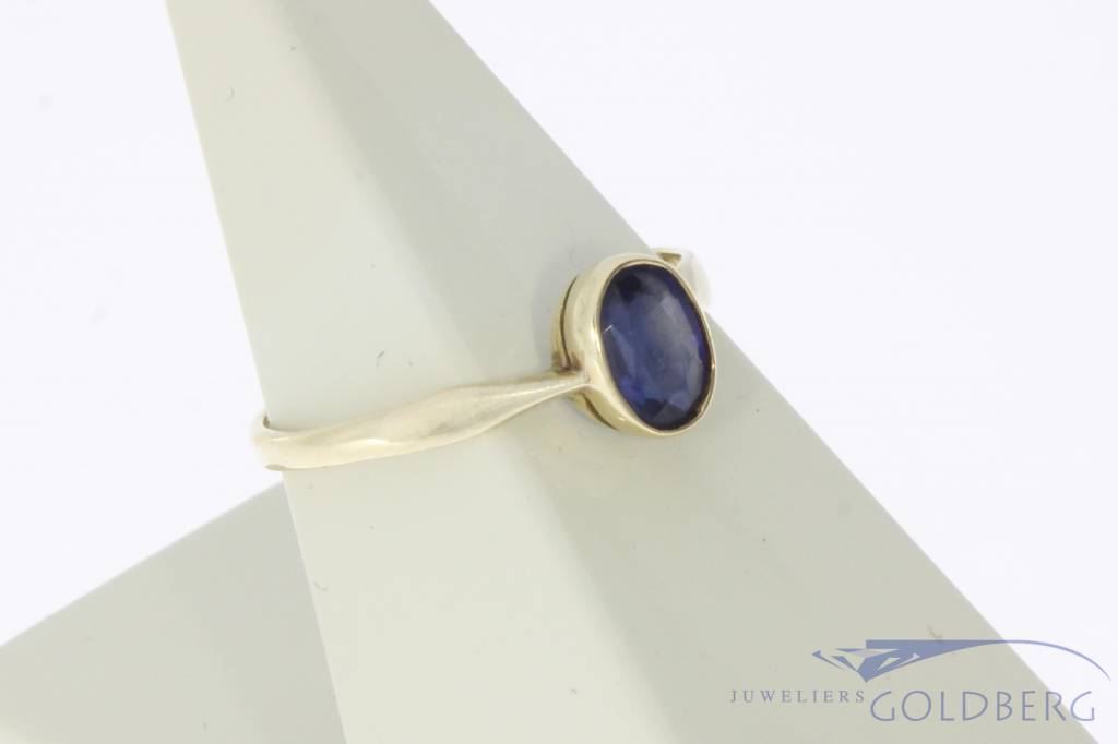 Vintage 14 carat gold solitaire ring with blue sapphire