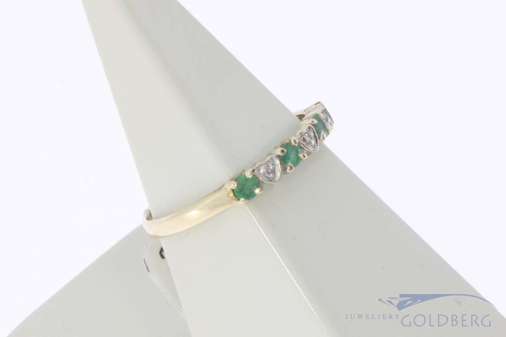 Vintage 14 carat gold alliance ring with emerald and diamond