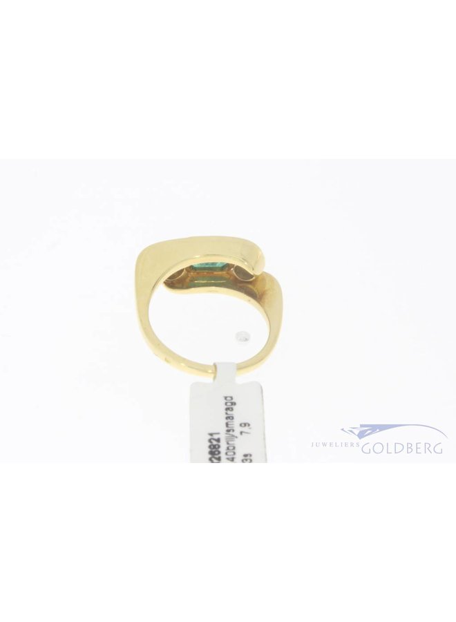18 carat yellow gold ring with emerald and approx. 0.40ct brilliant cut diamond