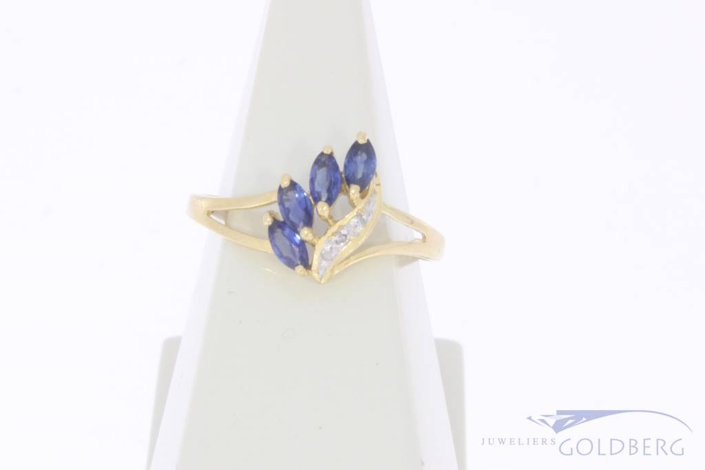 Vintage 18 carat gold ring with blue sapphire and small diamonds