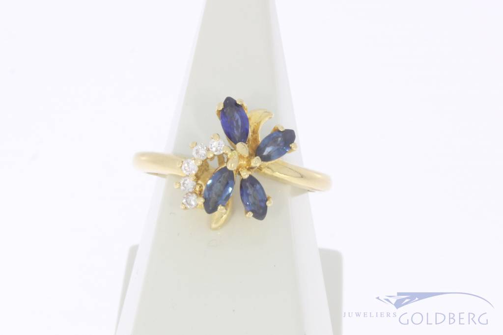 Vintage 18 carat gold flower shaped ring with blue sapphire and approx. 0.10ct brilliant cut diamond