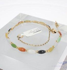 14k gold bracelet with various gemstones
