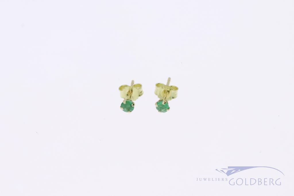 Small 14k gold earstuds with emerald