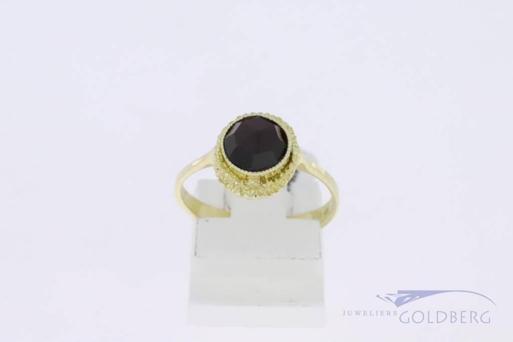 14k gold vintage design ring with garnet