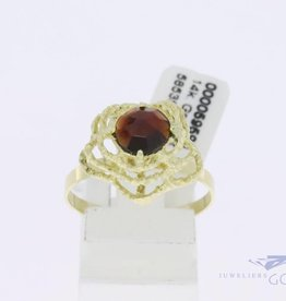 14k gold skletonized ring with garnet