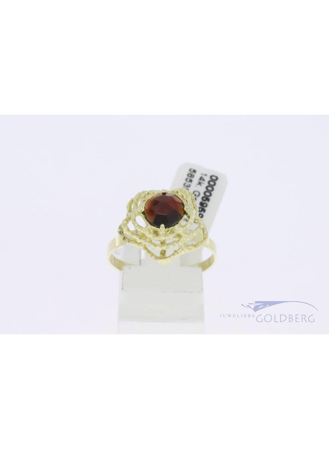 14k gold skletonized ring with garnet