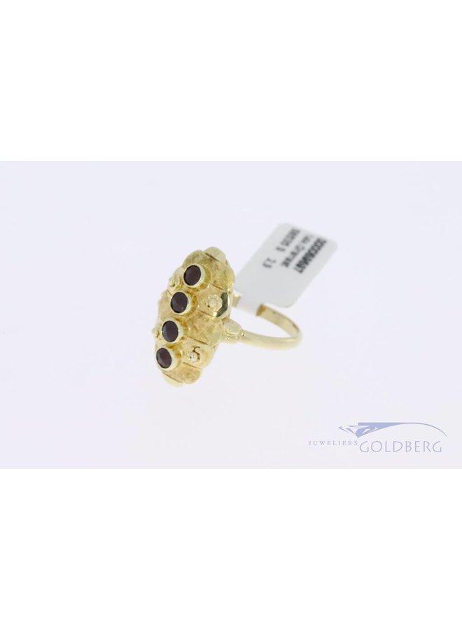 14k gold vintage ring with 4 garnets