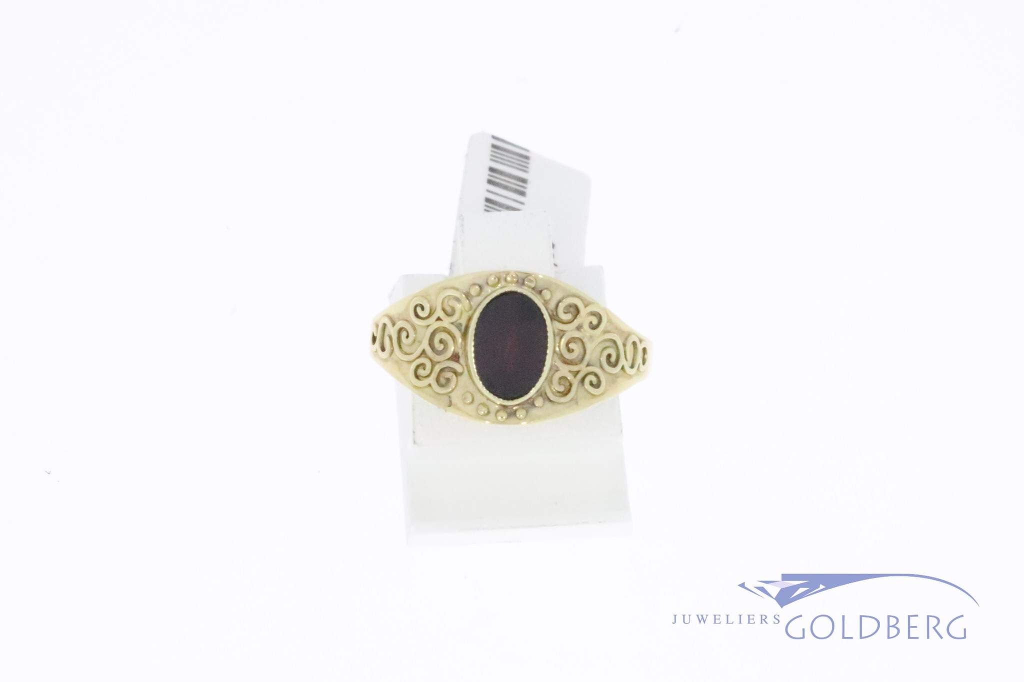 thin, 14k gold decorated vintage ring with garnet
