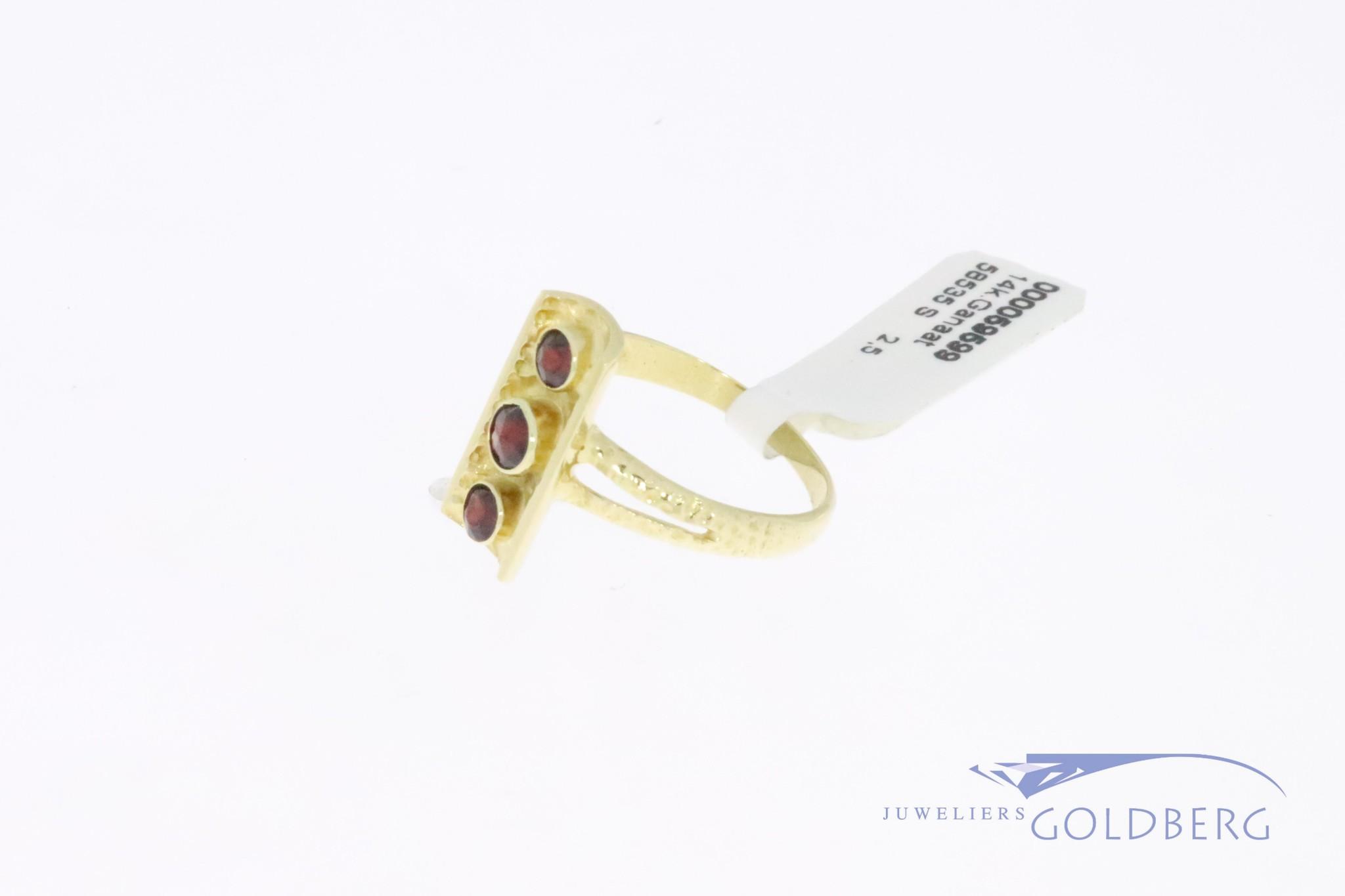 14k gold vintage design ring with 3 garnets