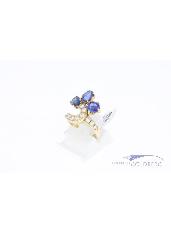 14k gouden vintage ring met briljant geslepen diamant (0.41ct) en saffier
