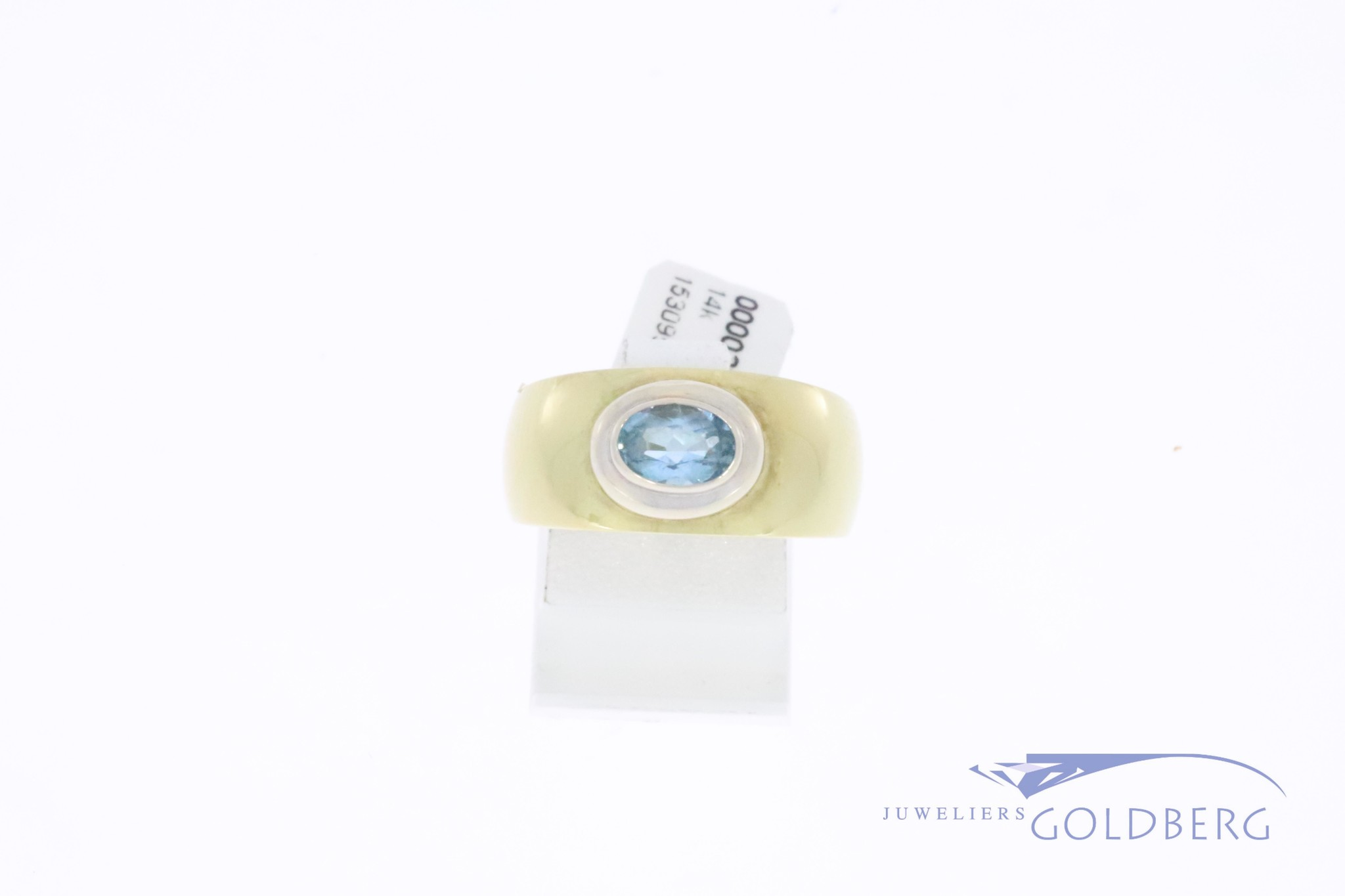 Beautiful wide/broad bicolor 14k gold vintage ring with aquamarine-colored synthetic spinel.