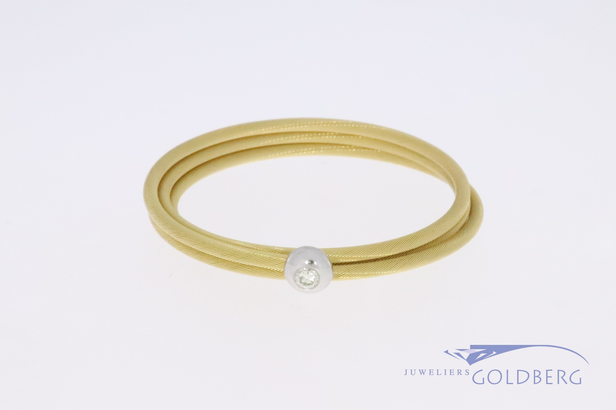 "18k gold coiled, ""springing"" bracelet with 0.10ct diamond"